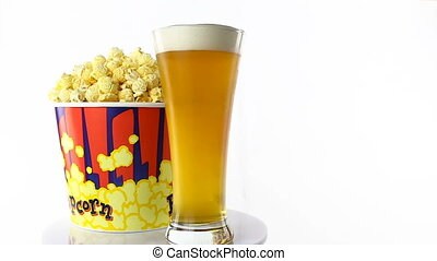 Bacon popcorn with beer rotates on a white background. Medium shot
