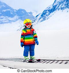 Child in ski school - Child in alpine ski school with magic...