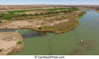 Aerial view of the Orange river and associated irrigation...