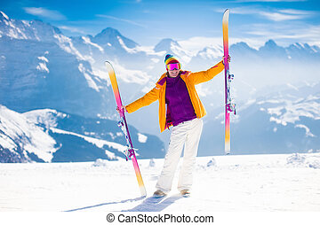 Young woman skiing in the mountains. - Young active woman...