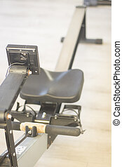 Gym exercise rowing machine static rower in gymnasium...