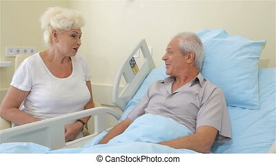 Old couple talks at the hospital - Couple of old people...