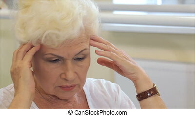 Senior woman has a headache - Senior woman having a...