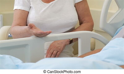 Senior ill man put his hand on his wife's palm - Senior ill...