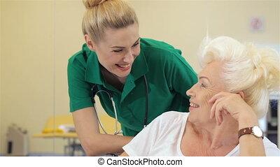 Nurse smiles for female patient
