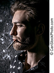 brutal man smoking - Smoking young man. Handsome young man...