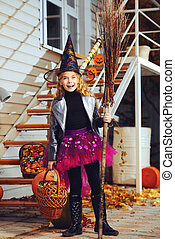 trick or treat - Pretty little girl in a costume of witch...