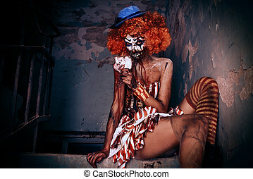sexy zombie clown - Bloody scary clown. Halloween. Horror.