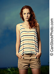 stormy day - Portrait of a beautiful young woman on the...
