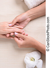 Mature woman in beauty saloon - Spa hand treatment. Top view...