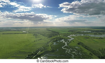 Flying Over Fields and River - Aerial shot: Flying Over...