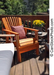 Sunny Adirondack Chair - Sunny adirondack chair on a deck in...