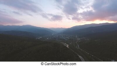 Aerial view. Mountains in the Carpathians. Small city