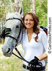 Girl and horse - Image of happy female looking at camera...