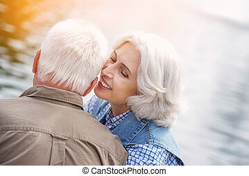 Mature loving couple has romantic date in park - I love you...