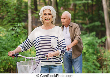 Happy mature husband and wife enjoying trip in park - Senior...