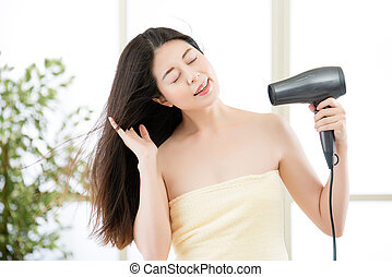 asian beauty woman hair dryer to drying hair after shower -...