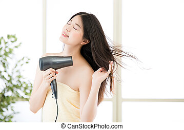 asian beauty woman hair dryer to drying hair after shower,...