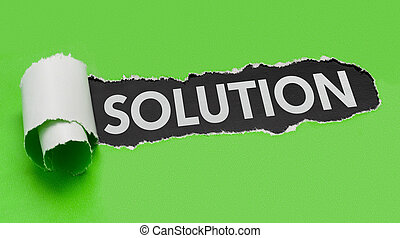 Torn green paper revealing the word Solution