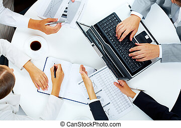Consulting - Above view of several business people working...