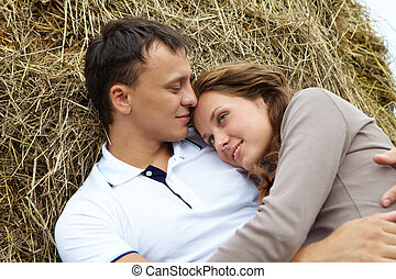 Serene couple - Photo of affectionate couple having rest on...