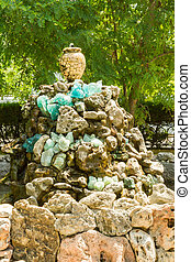 Fountain of the stones with a jug in summer Park