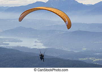 Extreme paragliding in high mountains Alps (Carinthia,...