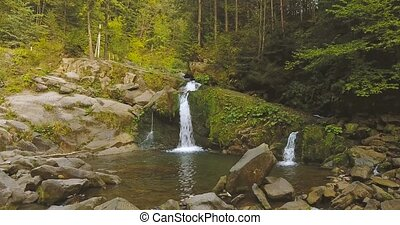 Waterfall in the Mountains in the Carpathians. Autum 2016