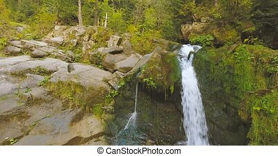 River Flows Over Rocks in this Beautiful Scene in the...