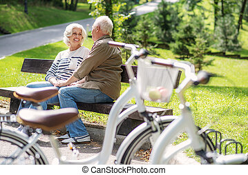 Mature lovers enjoying communication in park - Happy old...