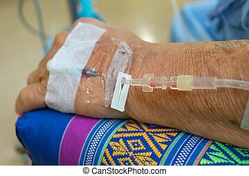 A patient in the hospital with saline intravenous, in Asian...