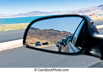 Road congestion reflection - Reflection of a car line in a...