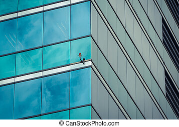 Glass office building - Big glass office building in a...
