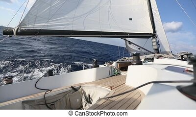 Sailing in the wind through the waves. Luxury yacht boat in...