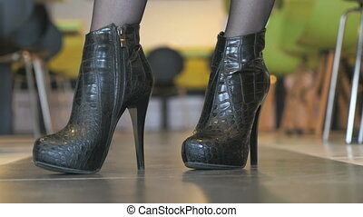 Girl advertises short boots from crocodile leather - Girl...
