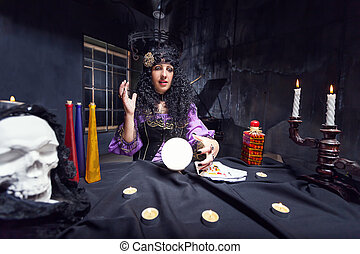 Sorceress in her room - Sorceress working with crystal ball...