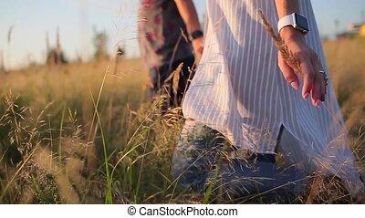 girl walking in the grass field