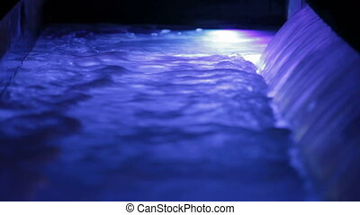 Waterfall with blue backlight