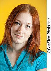 freckled young woman - Portrait of freckled young woman over...