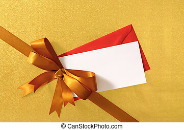 Christmas or birthday card with gift ribbon and bow in gold...