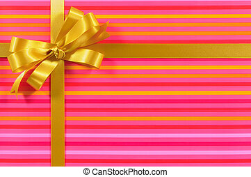 Gift border frame with gold ribbon bow and pink candy stripe...