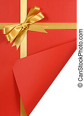 Red and gold gift with curled corner. - Red and gold...