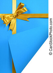 Blue and gold gift with curled corner - Gold gift ribbon on...