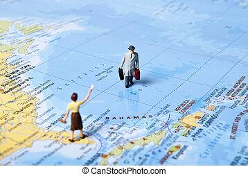world travel - miniature man on world map