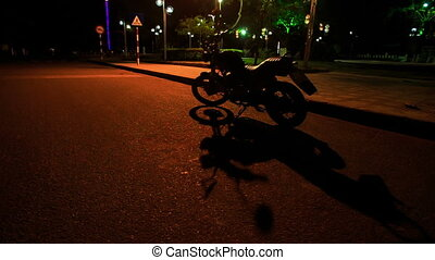 Guy in Helmet Mounts Motorcycle in Street Darkness - guy in...