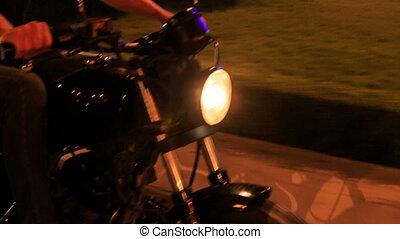 Closeup Motorcycle Speeds along Asphalt Road Barrier -...