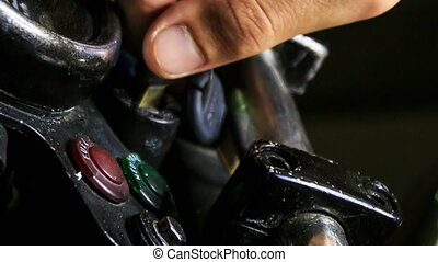 Closeup Guy Hand Turns Motorcycle Handle at Control Board -...