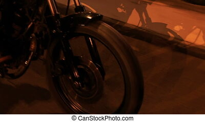 Closeup Motorcycle Speeds along Asphalt Road Barrier -...