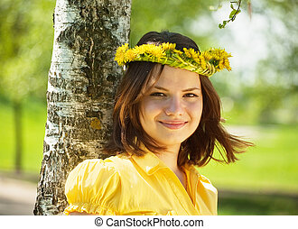 girl in dandelion wreath near birch - Brunette teen girl in...