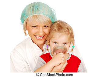 inhalation - female doctor gives the child inhalation